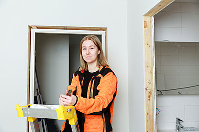 Young woman renovating house - p312m2262873 by Phia Bergdahl