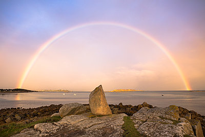 Rainbow over the ocean in Brittany, France - p1682m2260747 by Régine Heintz