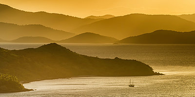 Lone Yacht at Sunset, Hamilton Island, Whitsunday Islands, Queensland, Australia - p651m2006274 by Tom Mackie