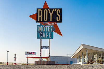 A classic retro looking sign for a gas station, motel and cafe along the historical Route 66 in the Mojave Desert, California, United States of America, North America - p871m2008743 by Alex Treadway