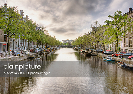 Boats in a Tree Lined Canal - p555m1453892 by Spaces Images