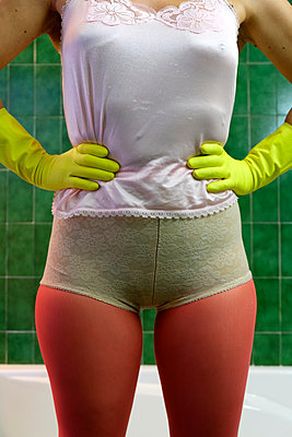 Woman in pantyhose wearing plastic gloves - p1521m2126559 by Charlotte Zobel