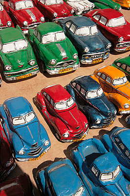 Small tin toy cars in street market - p3314433 by Gail Symes