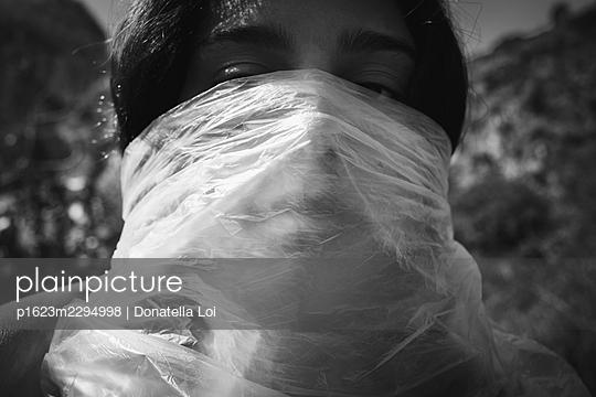 Girl under a plastic foil - p1623m2294998 by Donatella Loi