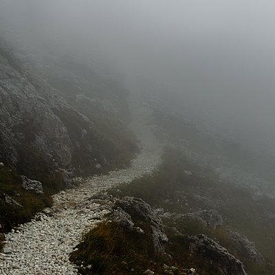 Hiking trail in the fog, Dolomites - p1624m2195911 by Gabriela Torres Ruiz