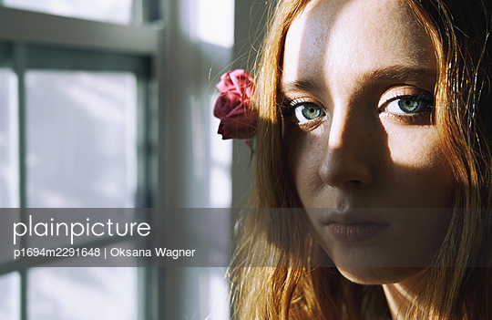 Young girl with flowers - p1694m2291648 by Oksana Wagner