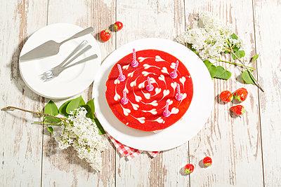 Strawberry-cream cake with birthday candles - p300m1028894f by Roman Märzinger