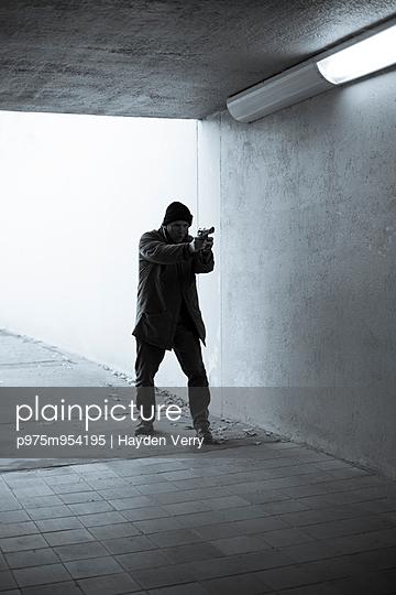 Man with Gun - p975m954195 by Hayden Verry