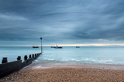 Ships off the coast at dawn - p1516m2158249 by Philip Bedford
