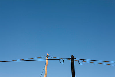 Wooden electric poles - p590m1467882 by Philippe Dureuil