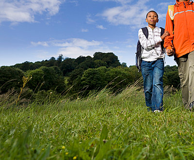 mother and son hiking - p4298415f by Colin Hawkins
