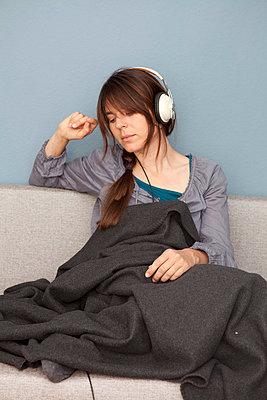 Woman with headphones - p4540871 by Lubitz + Dorner