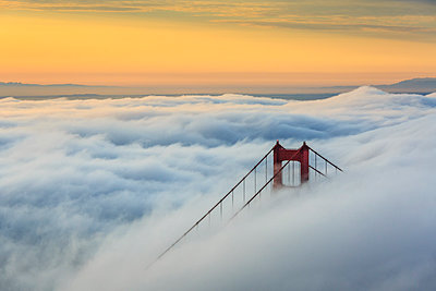 Golden Gate Bridge emerging from the morning fog at sunrise. San Francisco, Marin County, California, USA. - p651m2006660 by ClickAlps