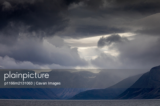 Cloud on top of mountains, Torngats Mountains National Park - p1166m2131063 by Cavan Images
