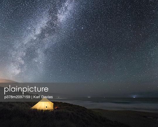 Tent under stars - p378m2097159 by Karl Davies