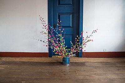 Coloured paper flowers in vessel - p1170m1090780 by Bjanka Kadic