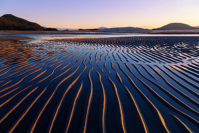Ripples are revealed as the evening tide recedes eagle beach state recreation area near juneau;Alaska united states of america - p442m837670f by John Hyde