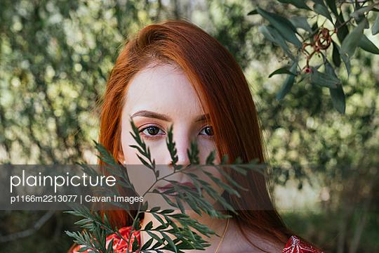 Portrait of a cute young re hair woman - p1166m2213077 by Cavan Images