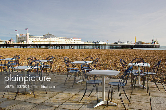 Tables and chairs on Brighton beach, England, United Kingdom - p871m837901 by Tim Graham