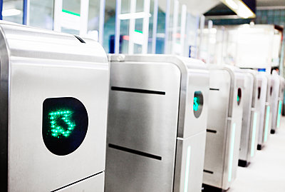 Row of electronic turnstiles - p312m1551891 by Johner Images