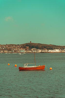 Fishing boat at anchor off the coast, Strangford, Northern Ireland - p1681m2283647 by Juan Alfonso Solis