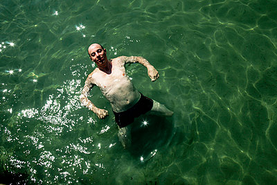 Man in Black Sea - p910m741515 by Philippe Lesprit