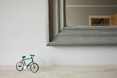 Miniature bicycle by mirror - p924m806987f by Ian Nolan