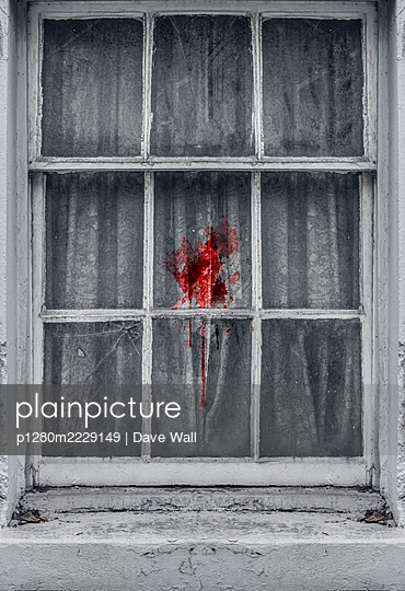 Curtain covered in blood behind old window - p1280m2229149 by Dave Wall