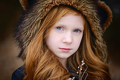 Young Girl Long Red Hair Wearing Bear Spirit Hood - p1166m2208458 by Cavan Images