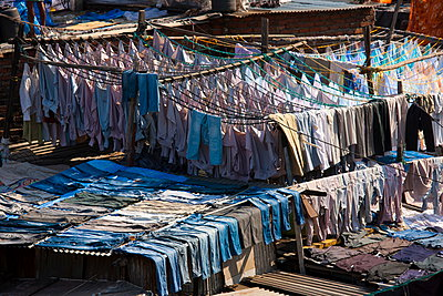 Traditional Indian professional hand laundry; Dhobi Ghat; in Mahalaxmi area of Mumbai; India - p871m923054 by Tim Graham