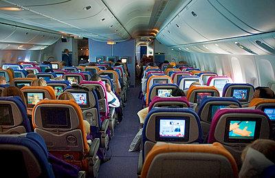Aircraft interior in flight - p1125m917391 by jonlove