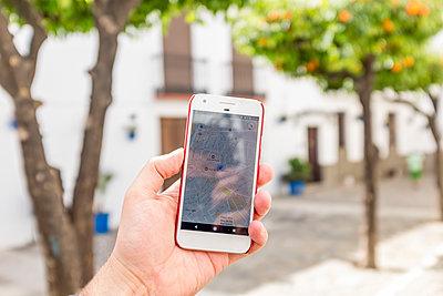 Using a smartphone navigation app - p890m1467382 by Mielek
