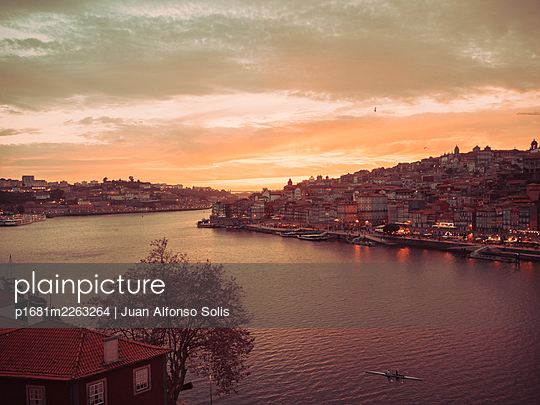 Portugal, View of Porto in the evening - p1681m2263264 by Juan Alfonso Solis