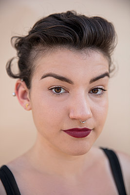 Portrait of confident hipster woman against colored background - p1166m2105714 by Cavan Images