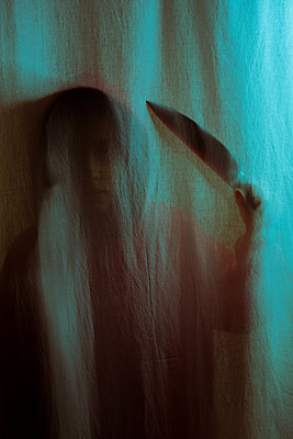 Person with knife behind a curtain - p1623m2215486 by Donatella Loi