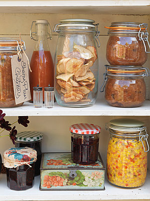 Dried and preserved foods in storage jars;  Battersea;  London;  UK - p349m920002 by Fiona Kennedy