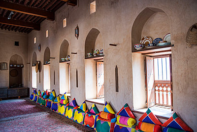 Middle East, Oman.  Interior of one of the elegant sitting rooms in Al Nakhal Fort - p652m1576192 by John Warburton-Lee