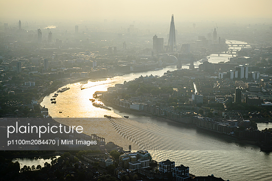 Aerial view of London cityscape and river, England,London, England - p1100m2084470 by Mint Images