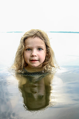 Child in deep water - p1019m1466279 by Stephen Carroll