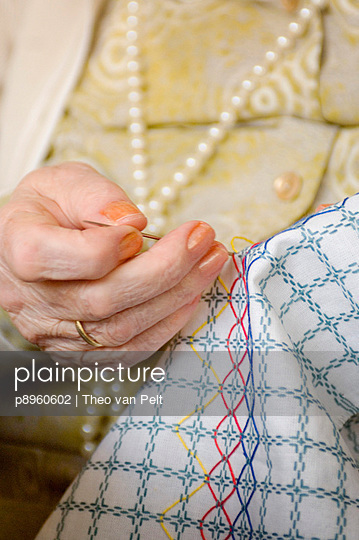 Hands of a senior woman doing needlework - p8960602 by Theo van Pelt
