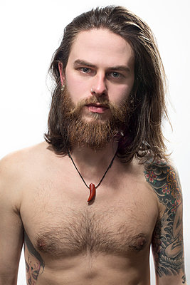 Young bearded man with tattoos - p975m900525 by Hayden Verry