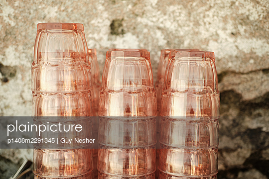 Stacked pink glasses - p1408m2291345 by Guy Nesher