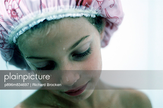 Girl with shower cap - p896m834697 by Richard Brocken