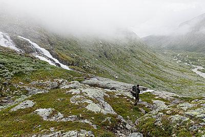Norway, Tourist walking in Jotunheimen range - p352m1349409 by Gustaf Emanuelsson