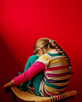 Sulky little girl - p445m1119669 by Marie Docher
