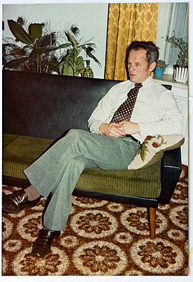 Vintage photograph showing man in living room - p265m1424825 by Oote Boe
