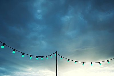 Fairy lights in the evening - p879m1538009 by nico