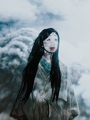 Young Asian woman in wood scenery - p1184m1441217 by brabanski