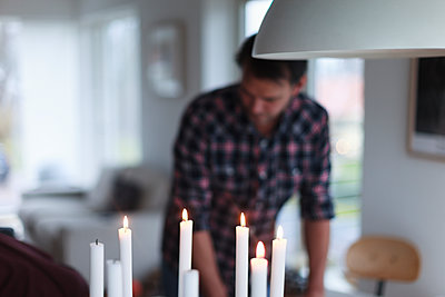 Burning candles, man on background - p312m1558348 by Christina Strehlow