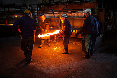 Red hot steel billet which has already been partially pre formed is moved back in to the furnace - p429m875669f by Charlie Fawell